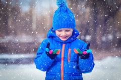 Ittle boy enjoy snow in winter nature Royalty Free Stock Images