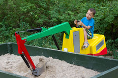 Ittle boy on an excavator Stock Photography