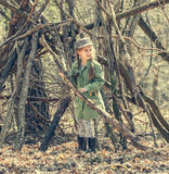 Ittle cute girl builds a hut in the woods Royalty Free Stock Photo