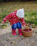 Ittle cute girl with cranberries basket Royalty Free Stock Images