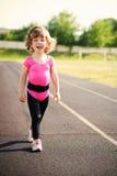 Ittle cute girl running at stadium Royalty Free Stock Photo