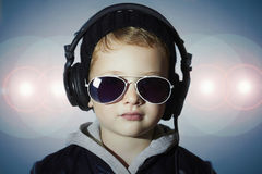 Ittle deejay. funny boy in sunglasses and headphones.child listening music Stock Photography