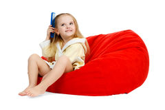 Ittle girl in a bathrobe combing your hair with a Royalty Free Stock Photo