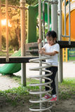 Ittle girl is climbing up on springs shape ladder royalty free stock image