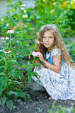 Ittle girl with curly hair about Royalty Free Stock Photos