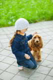 Ittle girl in denim suit with brown stock photos