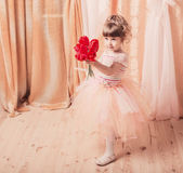 Ittle girl dressed as a ballerina in a tutu indoor Royalty Free Stock Photography