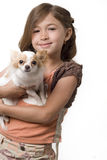 Ittle girl holding chihuahua puppy Stock Images