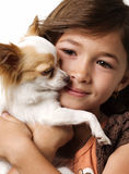 Ittle girl holding chihuahua puppy Royalty Free Stock Photo