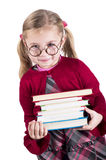 Ittle girl wearing spectacles holds books Stock Photo