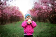 Ittle sweet girl drinks fruit juice. Pretty baby stock images