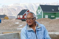 ITTOQQORTOORMIIT, GREENLAND - September 9, 2012:. Old man living in this small town on the eastern side of the island. The main economy is whale and polar bear stock photo