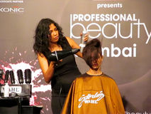 Itty Agarwal doing hairstyle. Its photo of hair styling session by Hair stylist Itty AgarwalEvent - Professional Beauty Expo 2015. Venue - Mumbai Date - 6th Oct stock image