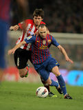 Iturraspe(L) vies with Iniesta(R) of Barcelona stock photo