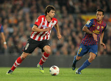 Iturraspe(L) vies with Thiago(R) of Barcelona Stock Images
