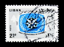 ITY Emblem and Cedars, International Tourist Year 1967 (II) serie, circa 1967. MOSCOW, RUSSIA - MARCH 18, 2018: A stamp printed in Lebanon shows ITY Emblem and stock photography