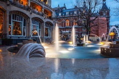 Сity fountain with illumination in twilight time. Stock Photography