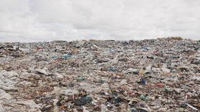 Сity garbage dump, environmental pollution due to lack of recycling technology stock footage