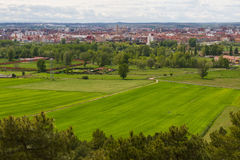 Ity of Leon in Spain. Wide overview of the city of Leon Spain in spring with fields of cereal and pine trees in foreground royalty free stock photography