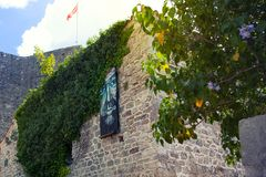 Ity Old Bar in Montenegro. Ancient stone wall with green ivy. Summer royalty free stock photography