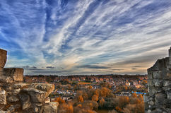 Сity view at sunset. City town villaje sunset sky clouds cloudy trees ruins autumn Royalty Free Stock Images