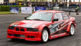 Iulian Jumuga (Jumy). At AutoMotoShow 2014 with BMW E36 V8 royalty free stock image