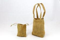 Iuta del cordone delle borse di tela da imballaggio isolata Fotografia Stock Libera da Diritti