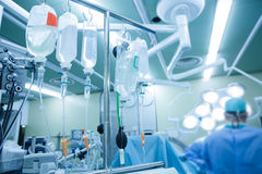IV bags and bottles hanging on poles during a real surgery Royalty Free Stock Image