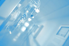 Iv drip in blurred hospital hallway.  Royalty Free Stock Photos