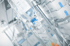 Iv drip in ward on the background of modern equipment Royalty Free Stock Image