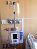 IV pole containing antibiotics in hospital room Stock Photos