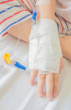 IV solution in a child's patients hand Stock Image