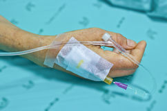 IV solution in a patients hand. Royalty Free Stock Photo