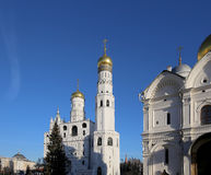 Ivan the Great Bell-Tower complex with New Year Christmas  tree. Cathedral Square, Inside of Moscow Kremlin, Russia. Royalty Free Stock Photography