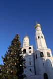 Ivan the Great Bell-Tower complex with New Year Christmas  tree. Cathedral Square, Inside of Moscow Kremlin, Russia. Stock Photography