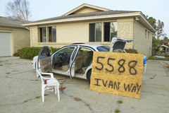 Ivan Roadway sign and debris in front of house heavily hit by Hurricane Ivan in Pensacola Florida Royalty Free Stock Photography