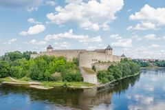 Ivangorod fortress on the Bank of the Narva river in the summer noon stock photography
