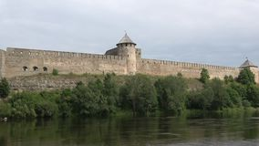 Ivangorod fortress on the river Narva cloud day in august. Russia stock footage