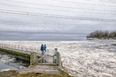 Ivangorod. Russia. Russian - Estonian border with Narva Reservoir. Ivangorod. Russia. Narva Reservoir. People standing on the icebreaking wall, and the royalty free stock photos