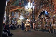 People praying inside of church during service. Ivano-Frankivsk region / Uklraine 24 October 2017 stock image