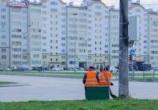 Ivano-Frankivsk, Ukraine - April, 3, 2018: Municipal workers have a rest on Ivano-Frankivsk street