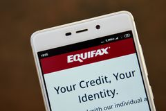 Equifax logo seen on the smartphone screen stock image
