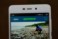 Greenpeace logo seen on the smartphone screen. Ivano-Frankivsk, Ukraine - May 9, 2019: Greenpeace logo, on the smartphone screen. Greenpeace website displayed on stock images