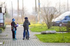 Ivano-Frankivsk, Ukraine - November 22, 2017: Boys friends on a. Bicycle outside. Children playing outdoors Royalty Free Stock Image