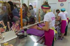 Ivano-Frankivsk, Ukraine - October 17, 2015: Children watch craft Stock Photography