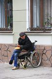Invalid in the chair asks for alms. Ivano-Frankivsk, Ukraine 29 October 2017: invalid in the wheelchair chair asks for alms. Ivano-Frankivsk, Ukraine 29 October stock photos