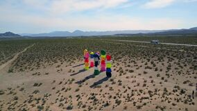 Aerial push, Seven Magic Mountains in desert near Las Vegas