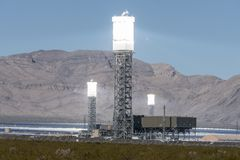 Ivanpah Power Tower Heat Shimmers. Ivanpah, California, USA - November 26, 2014:  Focused mirrors producing intense heat shimmers at the massive 392 megawatt Stock Photography
