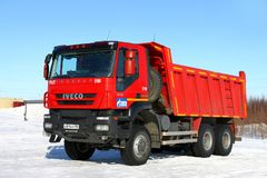 Iveco AMT Trakker. Novyy Urengoy, Russia - April 8, 2018: Red dump truck Iveco AMT Trakker in the city street royalty free stock image