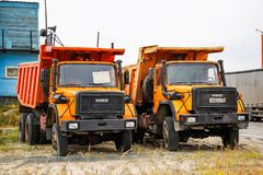 Iveco 330-30 ANW. Gubkinsky, Russia - September 8, 2014: Orange dump trucks Iveco 330-30 ANW in the city street stock photography
